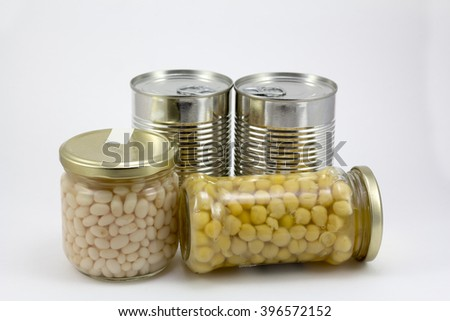 Canned food, beans and chickpeas isolated in a white background - stock photo
