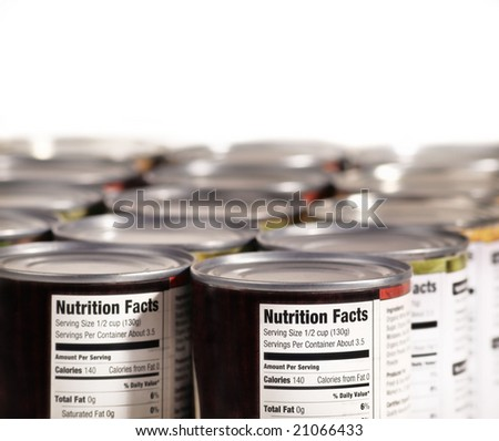 Canned food lined up on shelf with nutrition fact label - stock photo