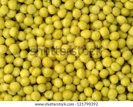 Canned green peas background - stock photo