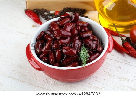 Canned kidney bean in the bowl on wood background - stock photo
