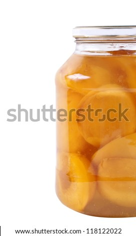canned peaches in a glass jar a white background