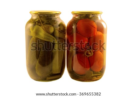 Canned vegetables cucumbers and tomatoes isolated on white background - stock photo