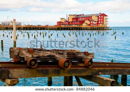 Cannery Pier in Astoria Oregon with water and rusted rail - stock photo