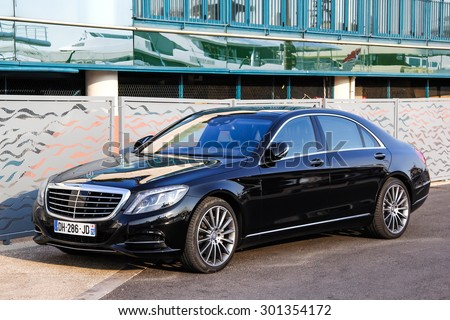 CANNES, FRANCE - AUGUST 3, 2014: Black luxury car Mercedes-Benz W222 S-class at the city street. - stock photo
