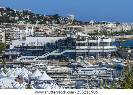 CANNES, FRANCE - AUGUST 30, 2011: Cityscapes Cannes. Cannes - a resort in southern France: many flowers and palm, luxury boutiques and restaurants, cafes, luxurious hotels - all for leisure travelers. - stock photo