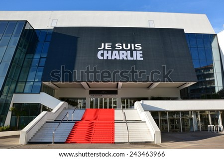 CANNES, FRANCE- JANUARY 12: Conference hall shown on january 12, 2015 in Cannes, France. Bill posting for pay tribute to twelve people killed in the attempt of the  newspaper Charlie Hebdo in Paris. - stock photo