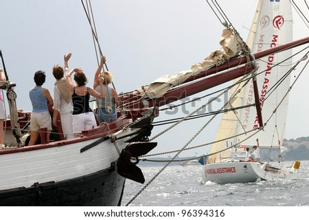 CANNES, FRANCE - JULY 23: Cannes-Istanbul Figaro Yacht Race. People wave to sailors, July 23, 2006. Cannes, France - stock photo