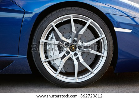 CANNES, FRANCE - JULY 29, 2015: Lamborghini Aventador wheel detail on July 29, 2015 in Cannes, France. Lamborghini is an italian brand of luxury sport cars. - stock photo