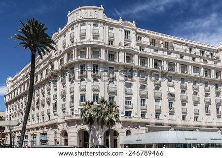 """CANNES, FRANCE - JULY 10, 2014: Luxury hotel """"Le Palais Miramar"""" (1929), located on famous """"La Croisette"""" Boulevard in Cannes, French Riviera. Miramar is one of most prestigious hotel in Cannes. - stock photo"""