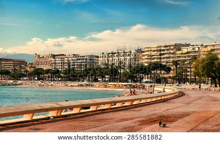 CANNES, FRANCE -  JULY 5, 2014. The beach in Cannes. Cannes located in the French Riviera. The city is famous for its Film Festival. FRANCE, - JULY 5, CANNES 2014 - stock photo