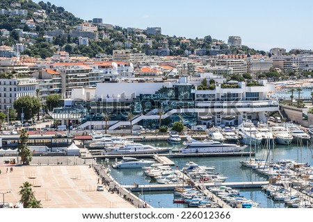 CANNES, FRANCE - JULY 10, 2014: View of Harbor and marina with moored yachts and motorboats in Cannes. Cote d'Azur.