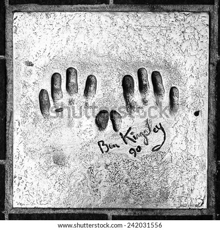 CANNES, FRANCE - JUN 25, 2014: Ben Kingsley hand mark on the alley of fame in Cannes, Cote d'Azur, France - stock photo