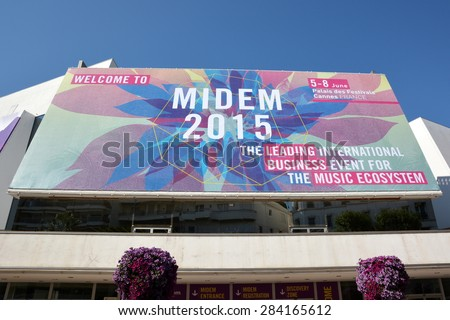 CANNES, FRANCE - JUNE 04: The poster for the MIDEMshown on june, 2015 in Cannes, France. The MIDEM is the leading international business event for the music, which takes place from 05 to 08 june 2015. - stock photo