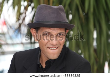 CANNES, FRANCE - MAY 21: Actor Roschdy Zem attends the 'Outside the Law' Photo Call held at the Palais des Festivals during the 63rd  Cannes Film Festival on May 21, 2010 in Cannes, France