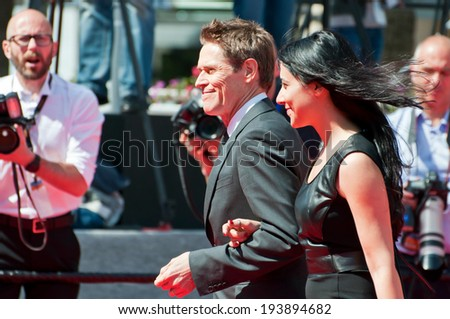 CANNES, FRANCE - MAY 20, 2014: Actor Willem Dafoe walks down the red carpet during the 67th Annual Cannes Film Festival on May 20, 2014 in Cannes, France. - stock photo