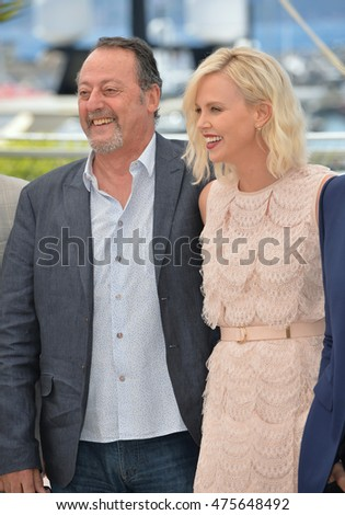 "CANNES, FRANCE - MAY 20, 2016: Actors Charlize Theron & Jean Reno at the photocall for ""The Last Face"" at the 69th Festival de Cannes."