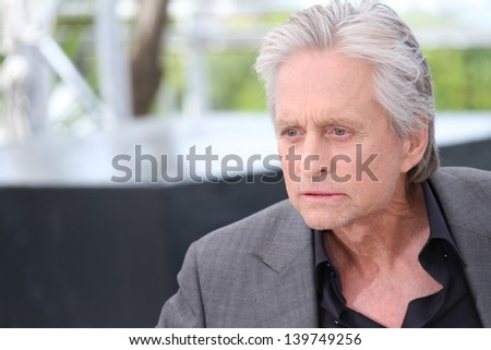 CANNES, FRANCE - MAY 21: Actors Michael Douglas attends the 'Behind The Candelabra' Photocall during The 66th Cannes Film Festival at the Palais des Festivals on May 21, 2013 in Cannes, France. - stock photo
