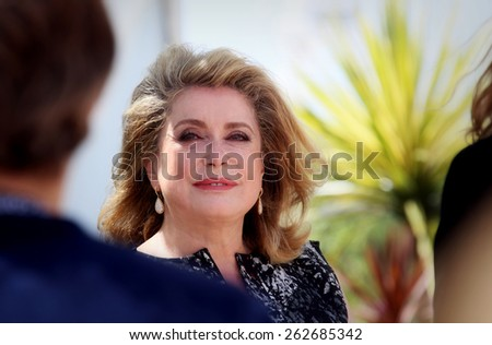 CANNES, FRANCE - MAY 21: Actress Catherine Deneuve attends 'L'Homme Qu'On Aimait Trop' photocall at the 67th Annual Cannes Film Festival on May 21, 2014 in Cannes, France. - stock photo