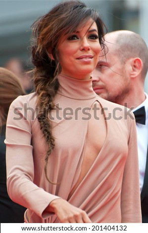 CANNES, FRANCE - MAY 19, 2014: Actress Eva Longoria walks down the red carpet during the 67th Annual Cannes Film Festival on May 19, 2014 in Cannes, France. - stock photo
