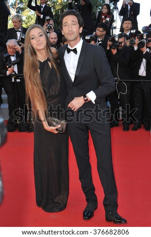 CANNES, FRANCE - MAY 24, 2014: Adrien Brody & girlfriend Lara Lieto at the gala awards ceremony at the 67th Festival de Cannes. - stock photo