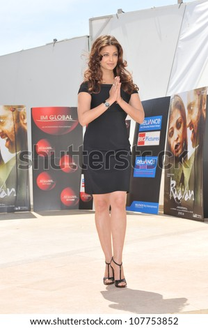 "CANNES, FRANCE - MAY 17, 2010: Aishwarya Rai Bachchan at photocall for her new movie ""Raavan"" at the 63rd Festival de Cannes. - stock photo"
