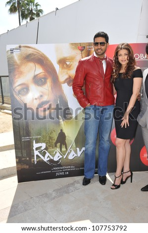 "CANNES, FRANCE - MAY 17, 2010: Aishwarya Rai Bachchan & husband Abhishek Bachchan at photocall for their new movie ""Raavan"" at the 63rd Festival de Cannes. - stock photo"
