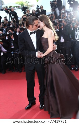 CANNES, FRANCE - MAY 16: Angelina Jolie, Brad Pitt attends 'The Tree Of Life' premiere during the 64th Annual Cannes Film Festival at Palais des Festivals on May 16, 2011 in Cannes, France. - stock photo