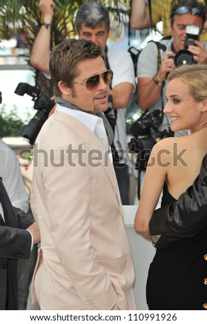 """CANNES, FRANCE - MAY 20, 2009: Brad Pitt & Diane Kruger at the photocall for their new movie """"Inglourious Basterds"""" in competition at the 62nd Festival de Cannes. - stock photo"""