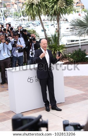 CANNES, FRANCE - MAY 16: Bruce Willis poses at the 'Moonrise Kingdom' photocall during the 65th Annual Cannes Film Festival at Palais des Festivals on May 16, 2012 in Cannes, France. - stock photo