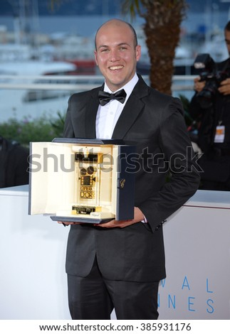 CANNES, FRANCE - MAY 24, 2015: Colombian director Cesar Augusto Acevedo - winner of the Camera d'Or Award - at the winners' photocall at the 68th Festival de Cannes. - stock photo