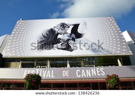 CANNES, FRANCE-MAY 14: Conference Hall facade shown on may 14, 2013 in Cannes, France.Palais des Festivals with the poster of the sixty sixth international movie festival rewarded by the golden palm.  - stock photo