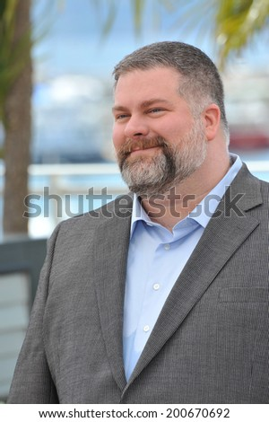 "CANNES, FRANCE - MAY 16, 2014: Director Dean Deblois at the photocall for his movie ""How to Train Your Dragon 2"" at the 67th Festival de Cannes.  - stock photo"