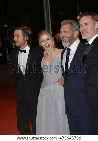 "CANNES, FRANCE - MAY 22, 2016: Director Jean-Francois Richet & actors Mel Gibson, Diego Luna & Erin Moriarty at the gala premiere for ""Blood Father"" at the 69th Festival de Cannes."