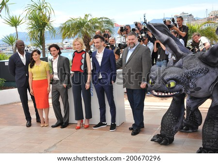 "CANNES, FRANCE - MAY 16, 2014: Djimon Hounsou, Cate Blanchett, America Ferrera, Jay Baruchel, Kit Harington & director Dean Deblois at the photocall for ""How to Train Your Dragon 2""  - stock photo"