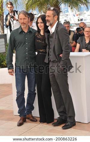 "CANNES, FRANCE - MAY 17, 2014: Eva Green, Mads Mikkelsen (left) & Jeffrey Dean Morgan at photo call for their movie ""The Salvation"" at the 67th Festival de Cannes.  - stock photo"