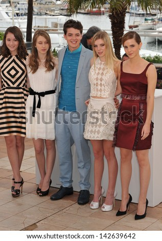 "CANNES, FRANCE - MAY 16, 2013: Katie Chang, Taissa Fariga, Israel Broussard, Claire Julien & Emma Watson at photocall for their new movie ""The Bling Ring"" at the 66th Festival de Cannes."