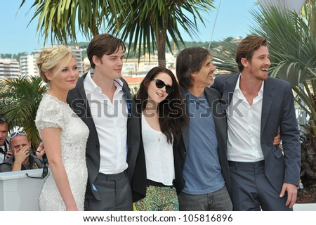 """CANNES, FRANCE - MAY 23, 2012: Kirsten Dunst, Sam Riley, Kristen Stewart, director Walter Salles & Garret Hedlund at the photocall for  """"On The Road"""" in Cannes. May 23, 2012  Cannes, France - stock photo"""