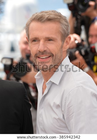"CANNES, FRANCE - MAY 18, 2015: Lambert Wilson at the photocall for his movie ""Enrages"" at the 68th Festival de Cannes."