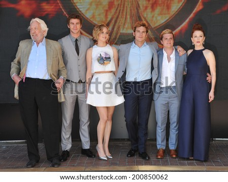 "CANNES, FRANCE - MAY 17, 2014: LtoR: Donald Sutherland, Liam Hemsworth, Jennifer Lawrence, Sam Claflin, Josh Hutcherson & Julianne Moore at photo call for ""The Hunger Games: Mockingjay - Part 1"""