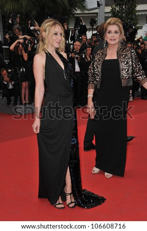 CANNES, FRANCE - MAY 22, 2011: Ludivine Sagnier & Catherine Deneuve at the 64th Festival de Cannes awards gala. May 22, 2011  Cannes, France