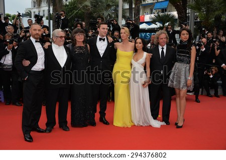 "CANNES, FRANCE - MAY 14, 2015: Mad Max: Fury Road director Georges Miller & stars Nicholas Hoult,Charlize Theron, Tom Hardy, Zoe Kravitz and Doug Mitchell  at premiere of ""Mad Max: Fury Road"".  - stock photo"
