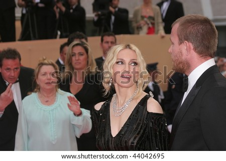 CANNES, FRANCE - MAY 21: Madonna (L) and Guy Ritchie attend the 'Che' premiere at the Palais des Festivals during the 61st International Cannes Film Festival on May 21, 2008 in Cannes, France. - stock photo