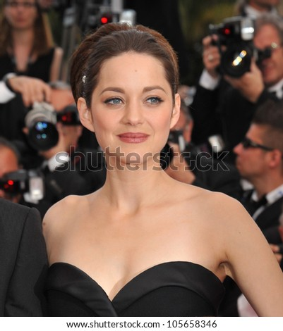 "CANNES, FRANCE - MAY 17, 2012: Marion Cotillard at the premiere of her new movie ""Rust & Bone"" in competition at the 65th Festival de Cannes. May 17, 2012  Cannes, France"
