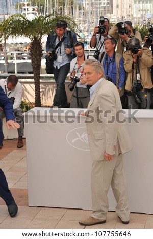 "CANNES, FRANCE - MAY 14, 2010: Michael Douglas at the photocall for his new movie ""Wall Street: Money Never Sleeps"" at the 63rd Festival de Cannes."