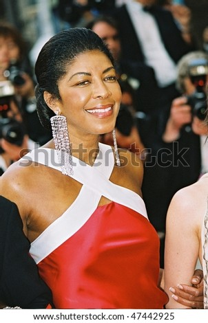 CANNES, FRANCE - MAY 22: Musician Natalie Cole arrives to the closing night ceremony and the screening of 'De-Lovely' during the 57th Cannes Film Festival on May 22, 2004 in Cannes, France - stock photo