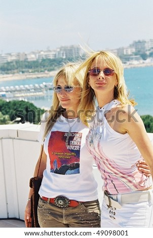 CANNES, FRANCE - MAY 16: Patricia and Rosanna Arquette at a photocall for Rosanna's film 'Searching for Debra Winger' at the Noga  during the 55th Cannes Film Festival in Cannes, France, May 16, 2002