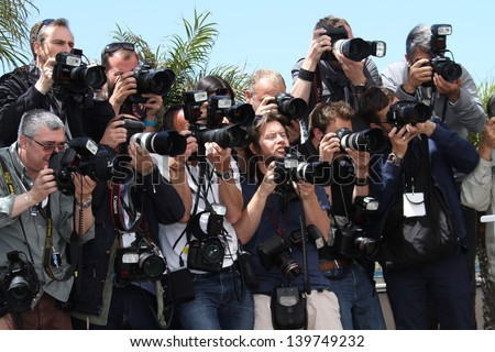 CANNES, FRANCE - MAY 21: Photographers attend the 'Ne Quelque Part' Photocall during The 66th Annual Cannes Film Festival at the Palais des Festivals on May 21, 2013 in Cannes, France. - stock photo