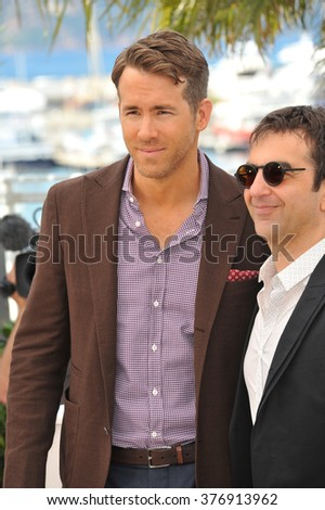 "CANNES, FRANCE - MAY 16, 2014: Ryan Reynolds & director Atom Egoyan at the photocall for their movie ""Captives"" at the 67th Festival de Cannes."