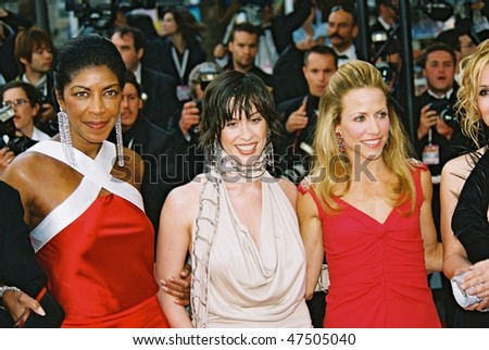 CANNES, FRANCE - MAY 22: Singers Natalie Cole, Alanis Morissette and Sheryl Crow arrive  the screening of 'De-Lovely' during the 57th Cannes Film Festival on May 22, 2004 in Cannes, France - stock photo