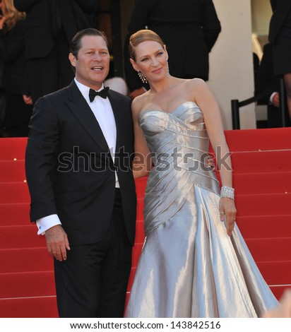 CANNES, FRANCE - MAY 26, 2013: Uma Thurman & partner Arpad Busson at the closing awards gala of the 66th Festival de Cannes.